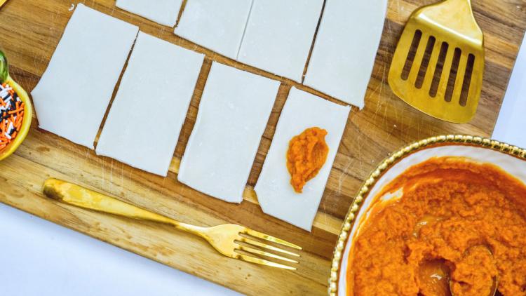 put a teaspoon of pumpkin onto each of the 8 rectangles